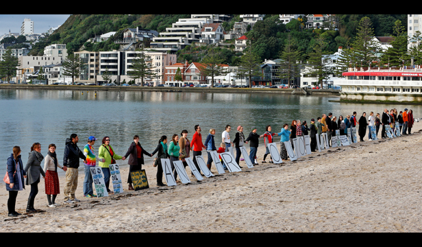 A large group gathers for Hands Across The Sand, 18th May 2013, Wellington